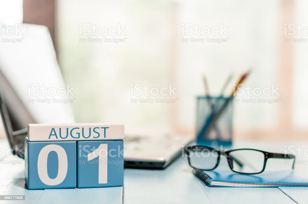 August 1st. Day of the month 1 wooden color calendar on business workplace background. Summer time. Empty space for text stock photo