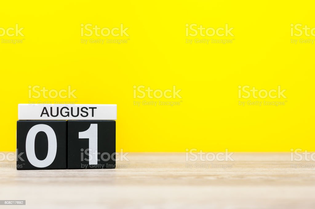 August 1st. Image of august 1, calendar on yellow background with empty space for text. Summer time - foto stock