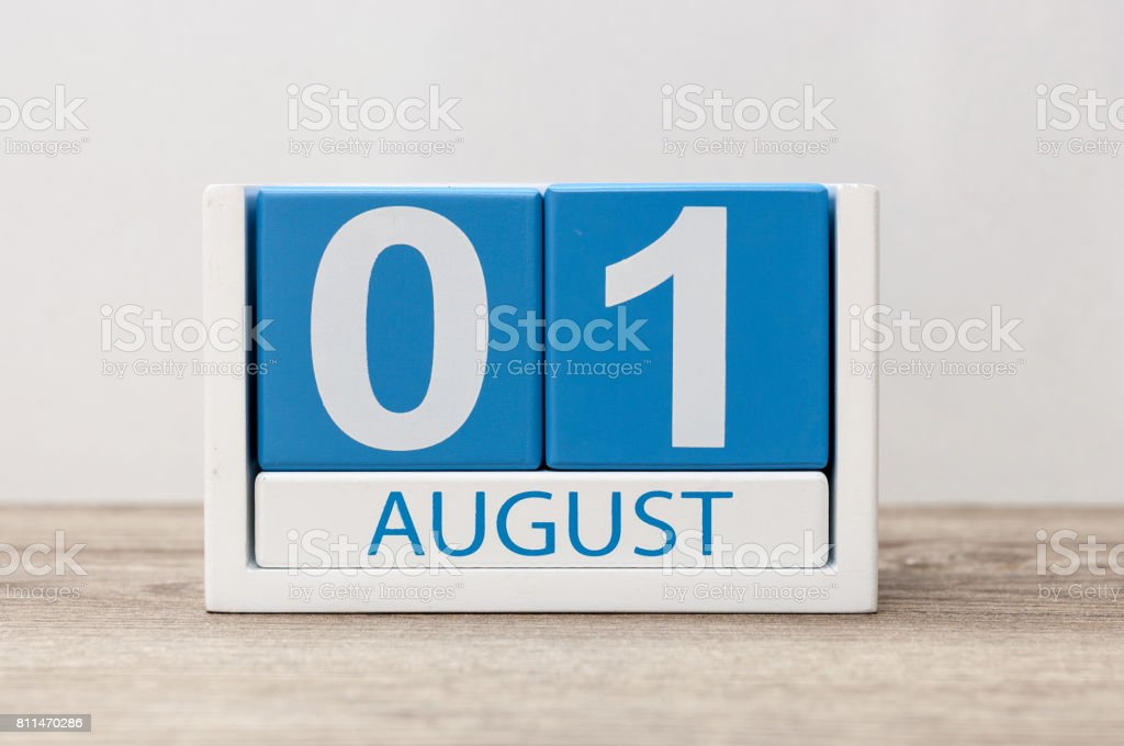 August 1st. Image of august 1, close-up wooden color calendar on white background. Summer day stock photo
