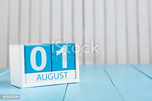 istock August 1st. Image of august 1 wooden color calendar on blue background. Summer day. Memorial Day of Victims of the First World War 825332284