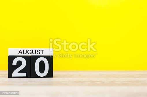 istock August 20th. Image of august 20, calendar on yellow background with empty space for text. Summer time 825208320