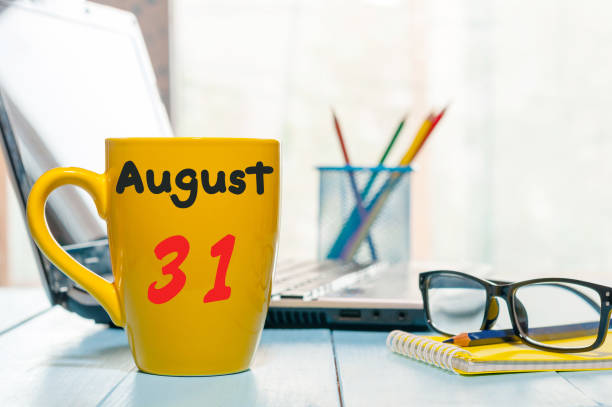August 31th. Day 31 of month, back to school time. Calendar on student or teacher workplace background. Summer end. Empty space for text stock photo