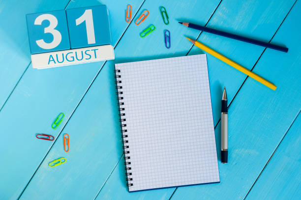 August 31th. Image of august 31 wooden color calendar on blue background. Last Summer day. Empty space for text. Blog Day stock photo