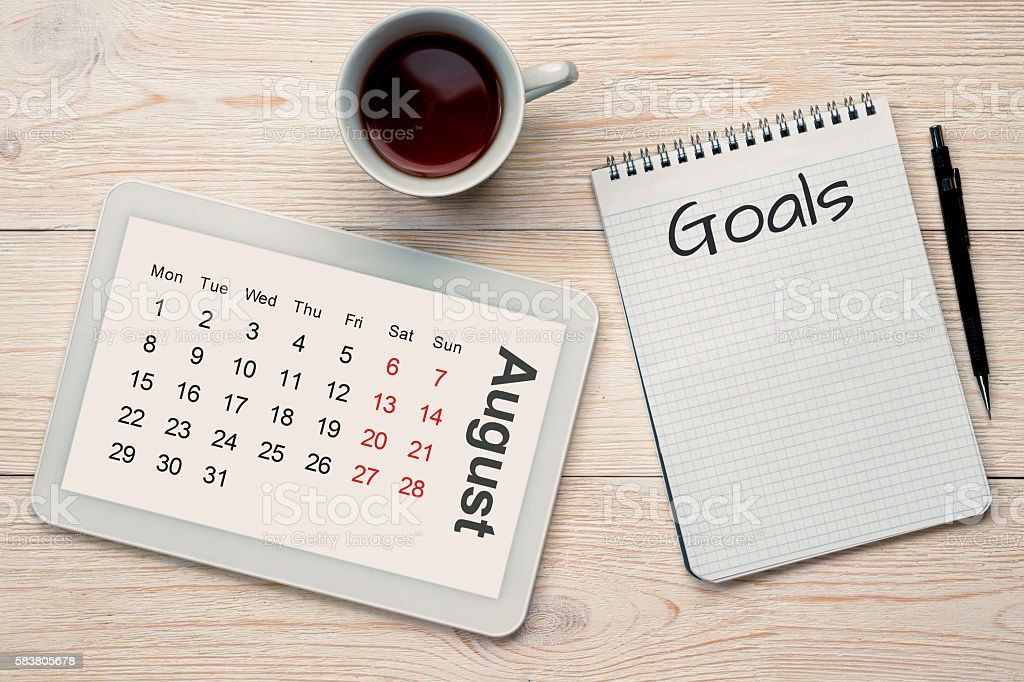 august calendar grid and goals stock photo
