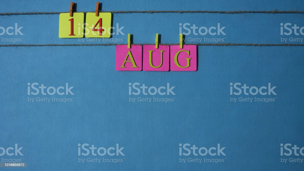 August, copy space with rope colored papers calendar stock photo