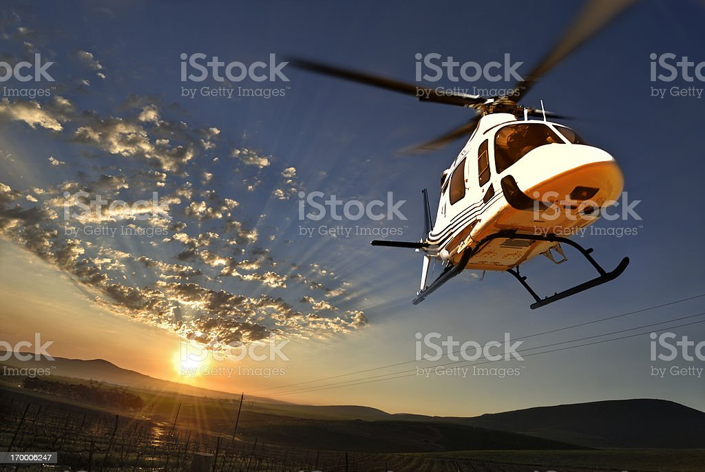 Augusta helicopter lit by setting sun stock photo