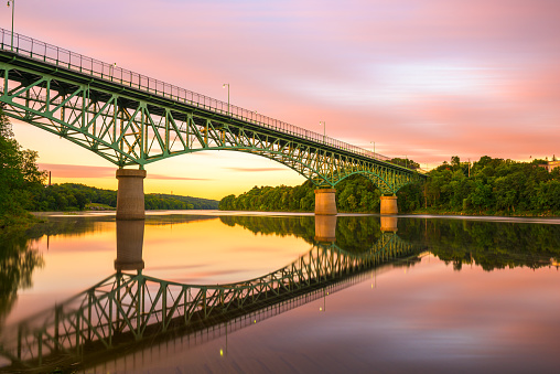 Augusta, Maine, USA view on the Kennebec River with Memorial Bridge at dawn.
