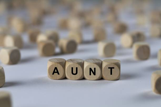 aunt - cube with letters, sign with wooden cubes stock photo