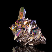 Aura quartz geode isolated on black background.