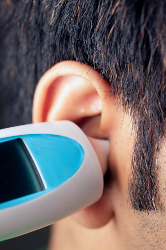 Aural (ear) thermometer in practical use.
