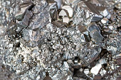 Auriferous Pyrite (Fe S2) gray stone crystals background