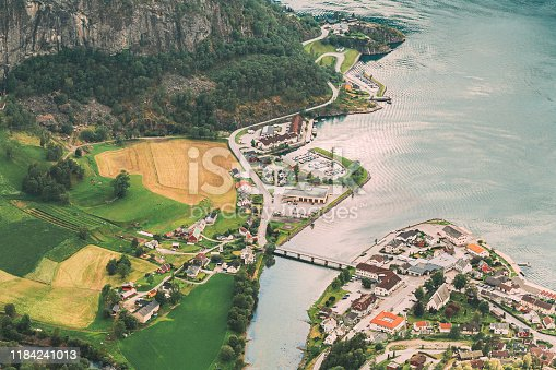 istock Aurland, Aurlandsvangen, Norway. Aurlandsvangen Seen From Stegastein Viewpoint In Sogn And Fjordane Fjord. Amazing Summer Scenic Aerial View Of Norwegian Town. Countryside Rural Landscape 1184241013