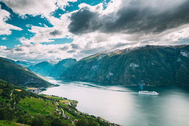 Aurland, Sogn And Fjordane Fjord, Norway. Amazing Summer Scenic View Of Sogn Og Fjordane. Ship Or Ferry Boat Liner Floating In Famous Norwegian Natural Landmark And Popular Destination In Summer Day stock photo