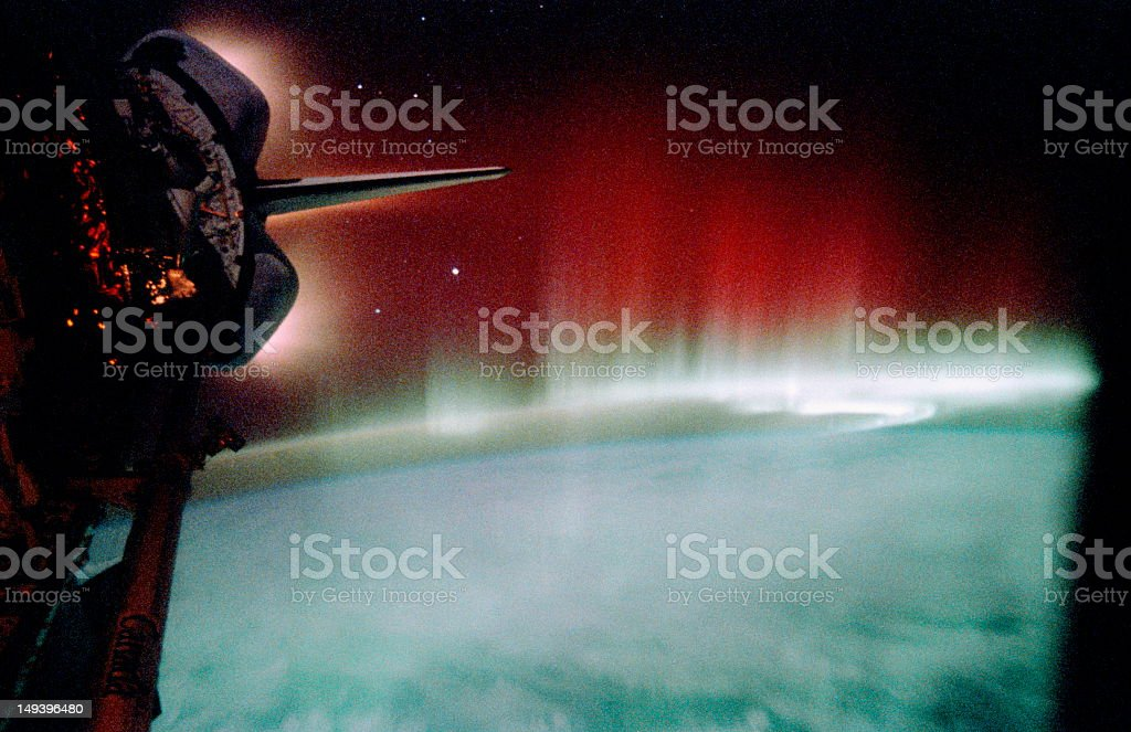Aurora and glowing Space Shuttle  thrusters (Enhancement) royalty-free stock photo