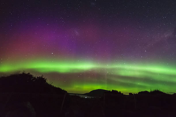 Aurora Australis beams at South Arm Tasmania stock photo