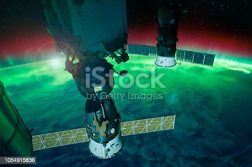 istock Aurora Australis from the Space Station.  Satellite view. Elements of this image furnished by NASA. 1054915836