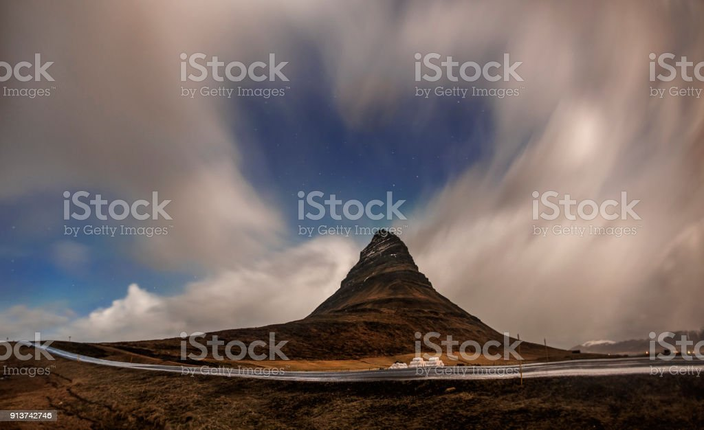 Aurora blasted in sky over Kirkjufell mountain at night, Iceland stock photo