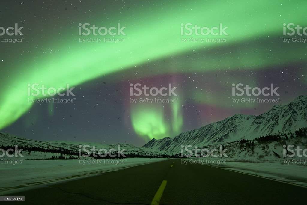 Aurora Borealis above road royalty-free stock photo