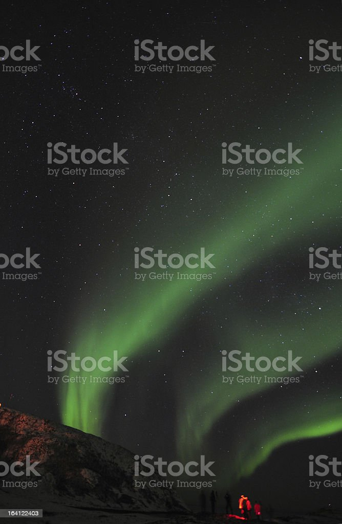 Aurora borealis and a group of photographers royalty-free stock photo