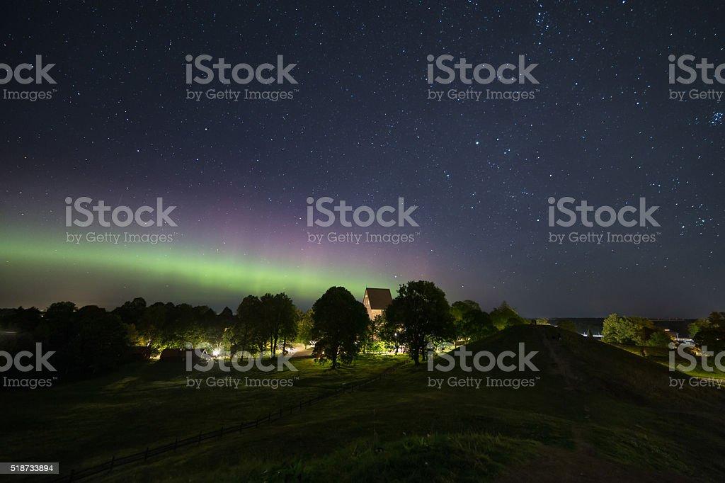 Aurora borealis and church stock photo