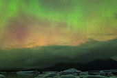 Aurora borealis in the night northern sky. Ionization of air particles in the upper atmosphere.