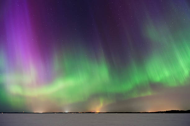 Aurora Borealis, Northern Lights, above frozen lake ストックフォト
