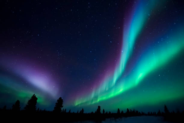 aurora borealis, northern lights - saturated color stock pictures, royalty-free photos & images