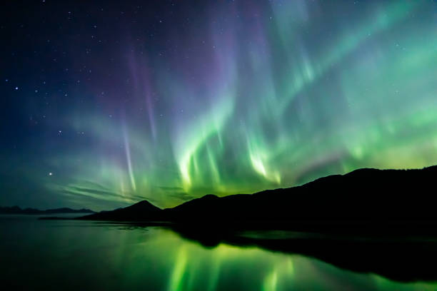 Aurora Borealis - northern lights - southeast Alaska Aurora Borealis (northern lights) in southeast Alaska seen in late summer beauty in nature stock pictures, royalty-free photos & images