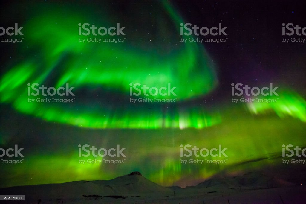 Aurora Borealis or better known as The Northern Lights for background view in Iceland, Snaefellsnesvegur during winter stock photo