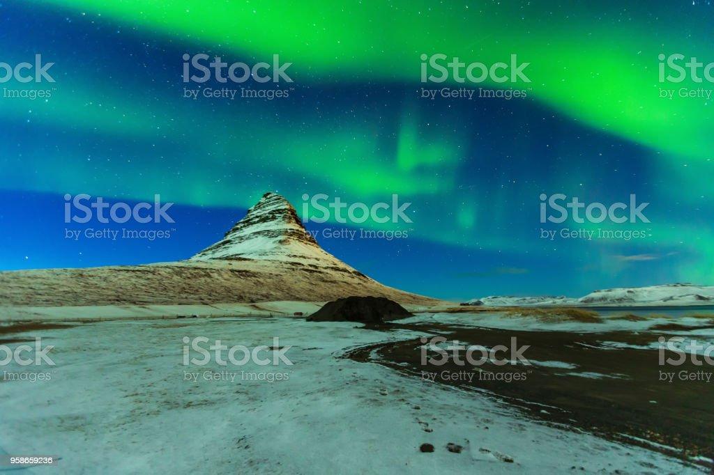 Aurora Borealis or northern light above kirkjufell mountain in iceland stock photo