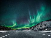 aurora borealis over asphalt road in Yukon,Canada.