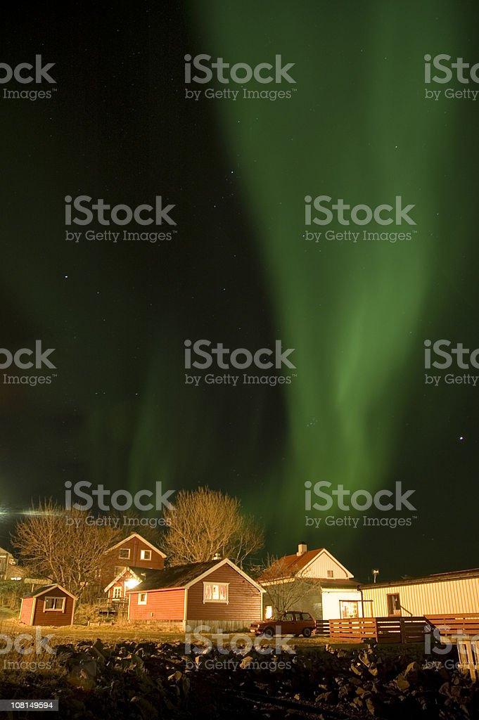 aurora borealis over boathouse stock photo