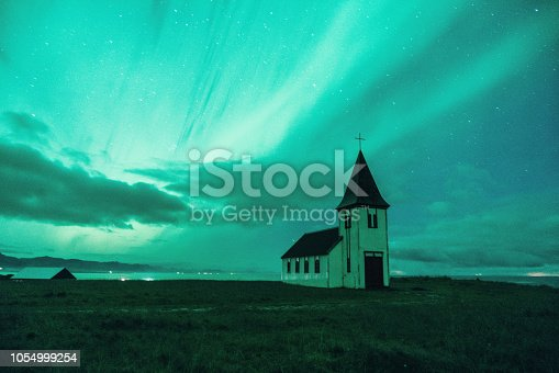 Scenic view of Aurora Borealis over church  in Iceland