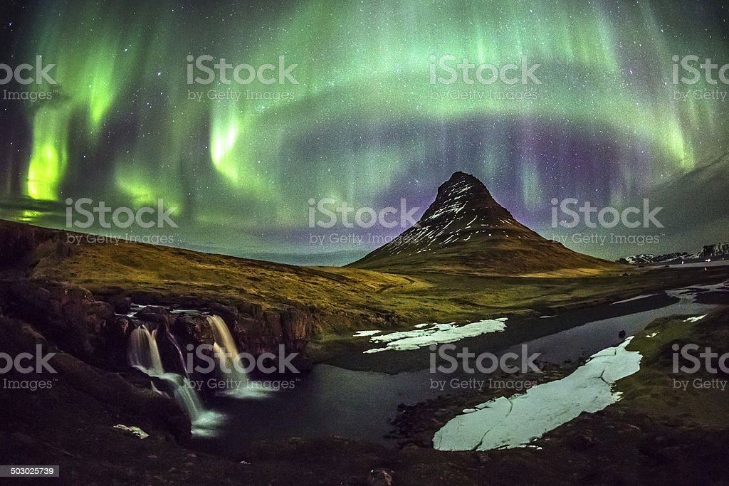 Aurora borealis over Mt. Kirkjufell in Iceland stock photo