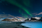 Aurora borealis over Skagsanden beach on Lofoten Islands, Norway, March 2016