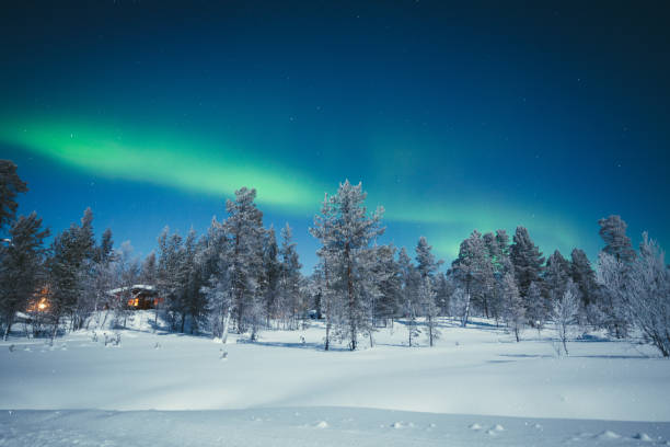 aurora borealis over winter wonderland scenery in scandinavia - finland stock pictures, royalty-free photos & images