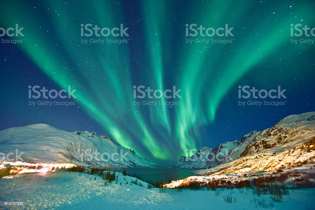 Aurora Borealis Aurora Borealis in Ersfjordbotn, Tromso Norway during winter season. Astronomy Stock Photo