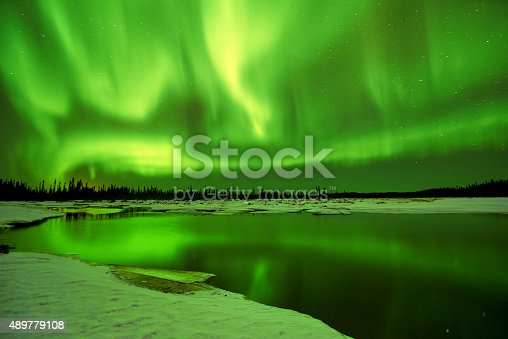 istock Aurora Borealis reflections in lake 489779108