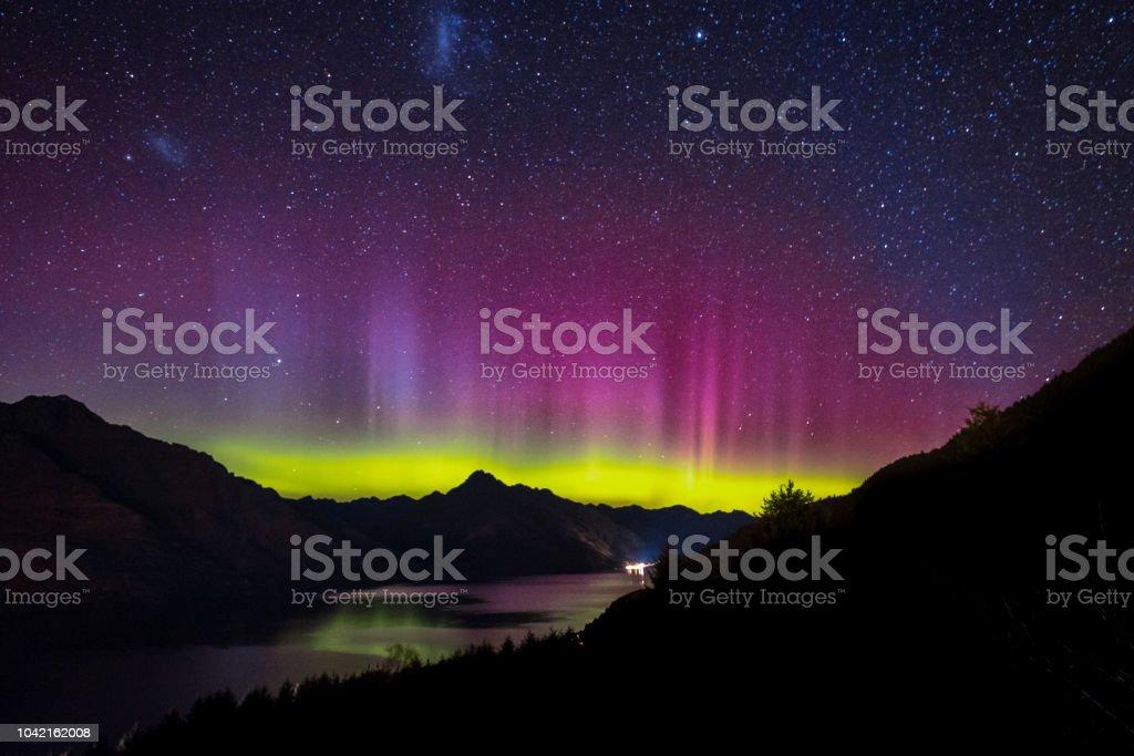 Aurora in the night sky of Queenstown, New Zealand stock photo