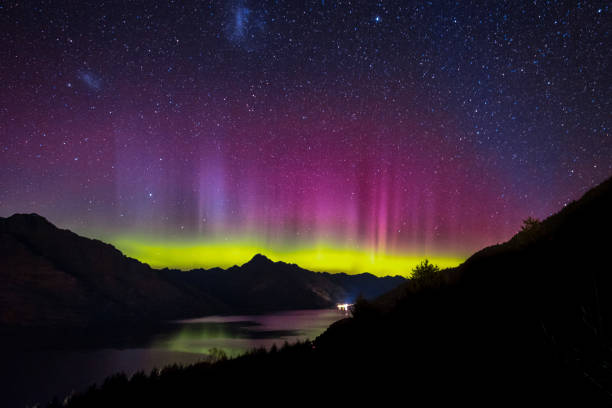 Aurora in the night sky of Queenstown, New Zealand stock photo