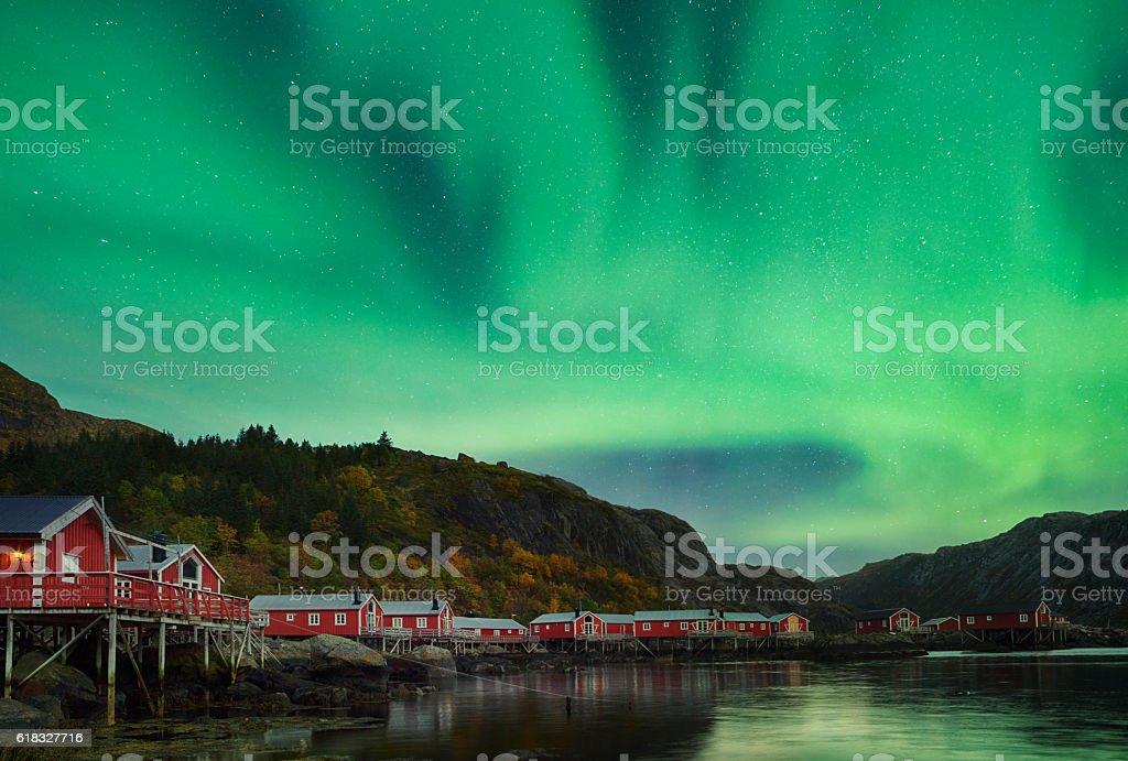 Aurora on Nusfjord Village, Lofoten, Norway stock photo
