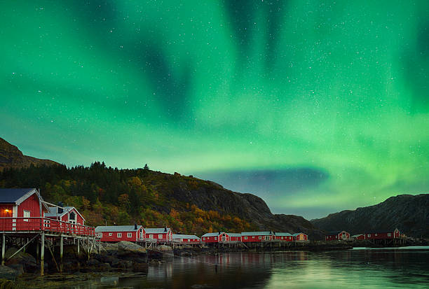 Aurora on Nusfjord Village, Lofoten, Norway - foto de acervo