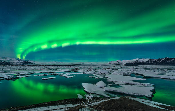 Aurora over Jokulsarlon Spectacular auroral display over the glacier lagoon Jokulsarlon in Iceland. jokulsarlon stock pictures, royalty-free photos & images