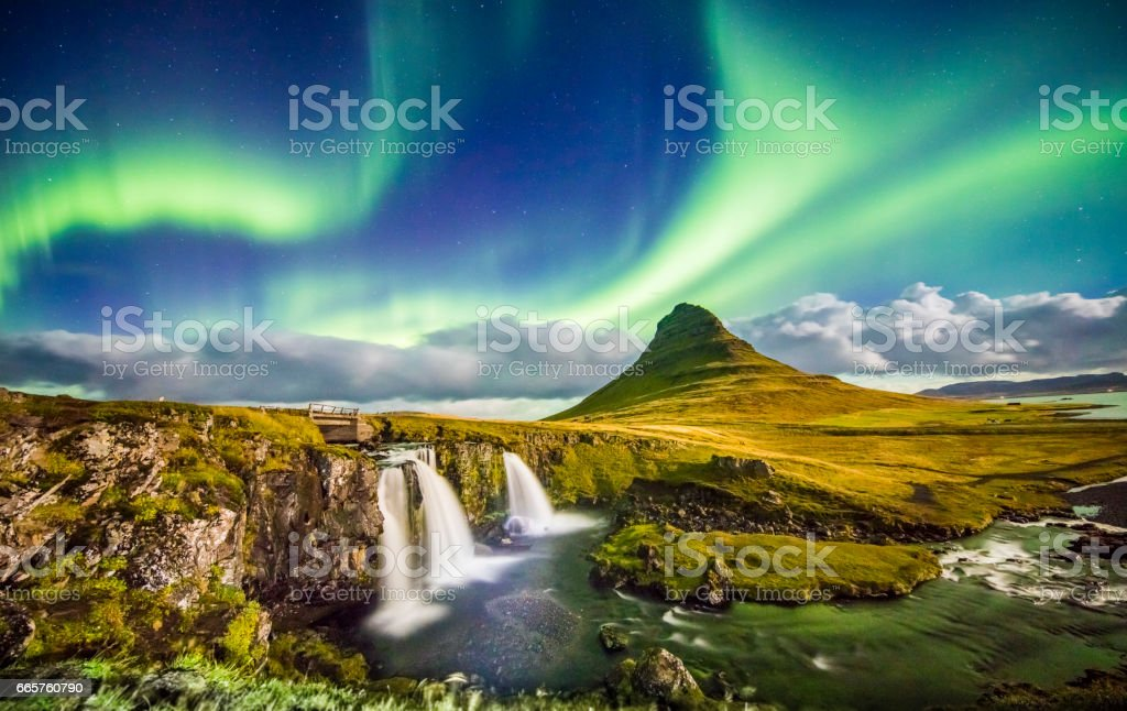 Aurora over Kirkjufell and waterfall at night stock photo