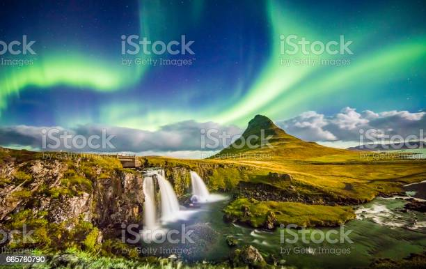 Scenic view of aurora over Kirkjufell and waterfall. Idyllic view of Northern Lights in Iceland. Beautiful view of nature at night.