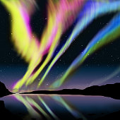 Multicolor aurora over lagoon and see the reflection on the water.