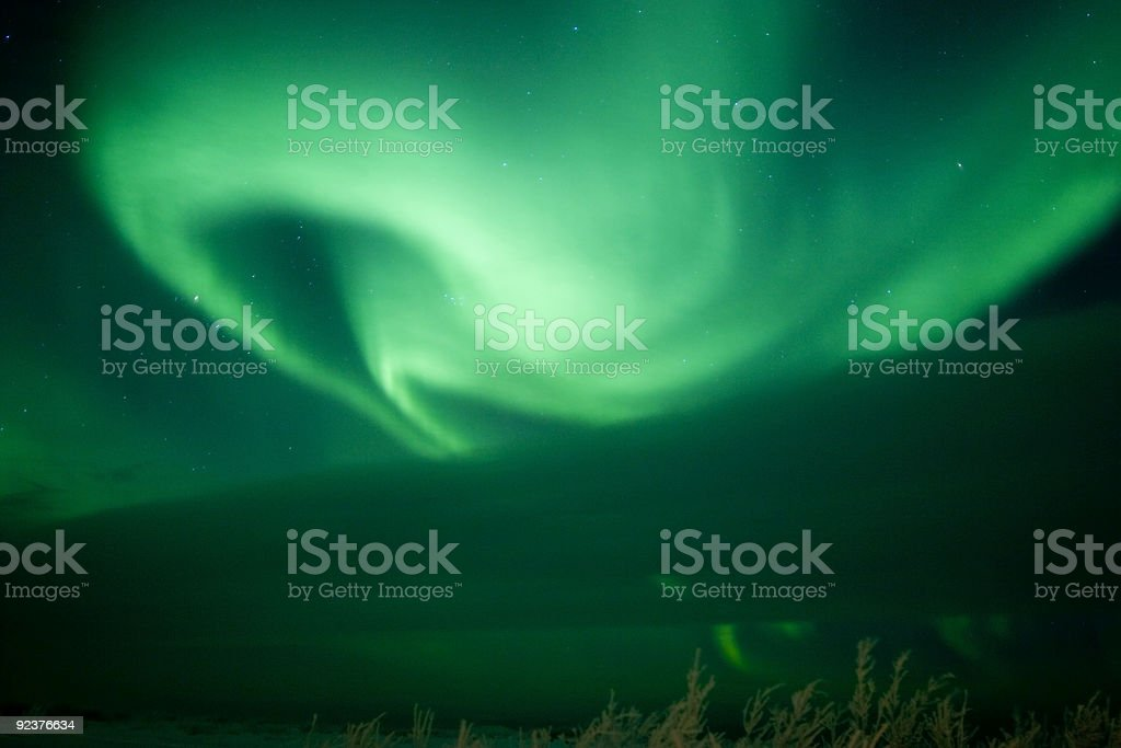 Aurora Swirl growing from behind cloud royalty-free stock photo