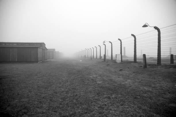 Auschwitz-Birkenau concentration camp. Death barrack. Jewish extermination camp. German death camp in Oświęcim. Barbed wire around from the camp. – zdjęcie
