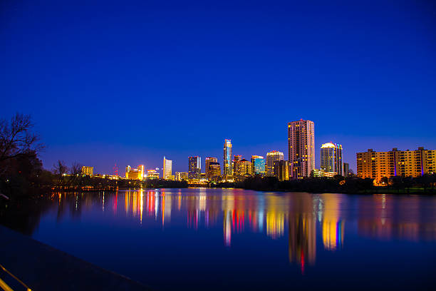 Austin at Night from Far Town Lake Reflection stock photo