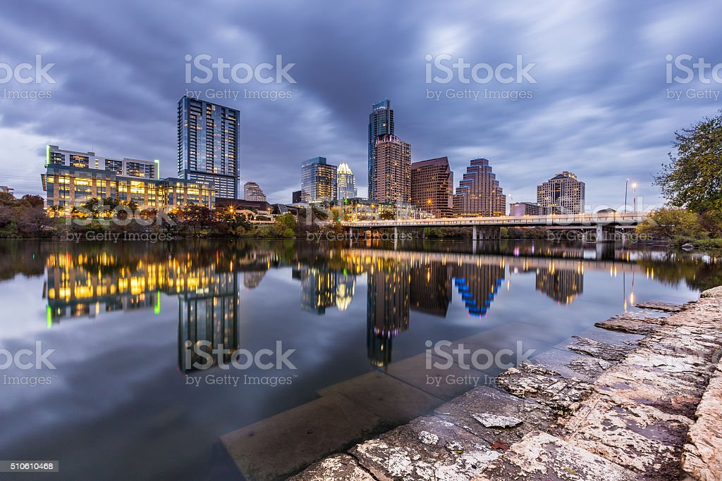 Austin downtown skyline by the river at night, Texas stock photo